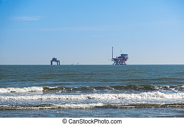 platform in the Sea . oil platform from the beach