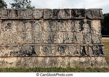 Platform of the Skulls in Chichen Itza, a.k.a. Tzompantli,...