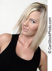 Platinum blonde in black tank top