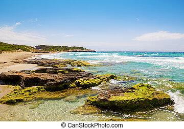 Platja de Sant Tomas beach at Menorca island, Balearic Islands, Spain.