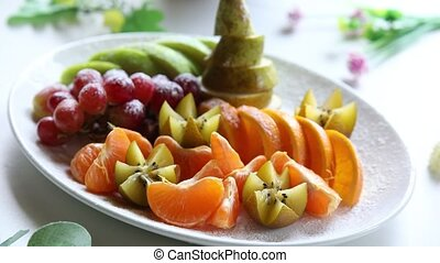 Platter of a assorted fresh fruit cut professionally