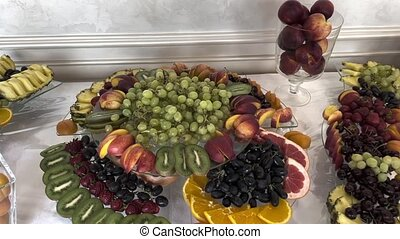 Platter of assorted fresh fruit at buffet table.