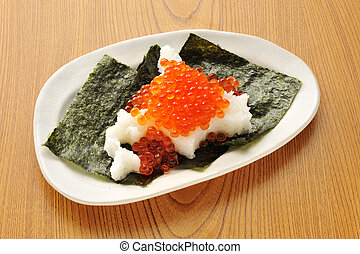 Platter of seaweed with salmon roe and plain rice in traditional japanese style on wooden table