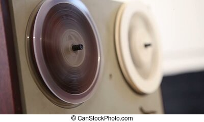 Play and rewind the tape in the old reel tape recorder, Old...