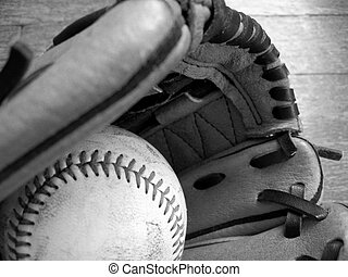 Baseball and leather glove. Black and white image.