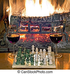 play chess drinking red wine in front of a roaring fireplace