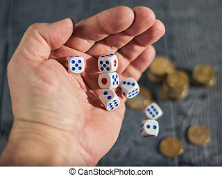 Play for money-tossing on the table with money dice.