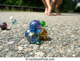 Play marbles 2 - A pyramid of marbles with someone trying to...