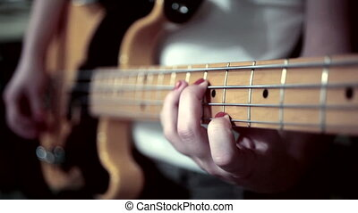play on bass guitar