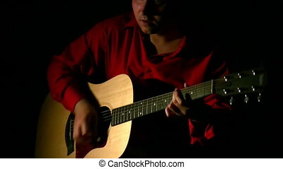play on guitar in dark. Face