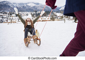 Play outdoors in a snow with daddy