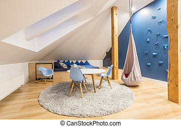 Play room at the attic with blue wall