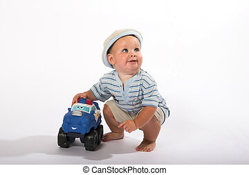 Young boy playing with toy car, insolated Young boy playing with toy car, isolated