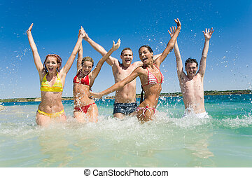 Image of happy teens playing while their vacation