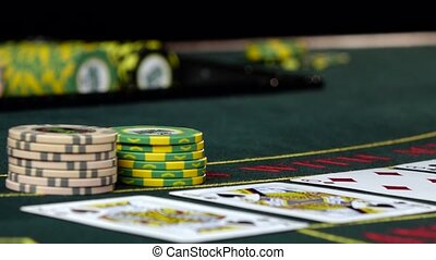Player at casino bets his chips playing poker, close up