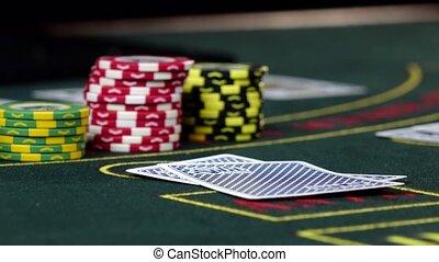Player at casino checks his cards playing poker, close up -...