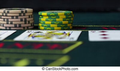 Player bets his chips playing poker, close up, slow motion