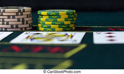 Player bets his chips playing poker, close up, front view -...