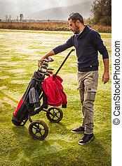 Player Choosing the golf club