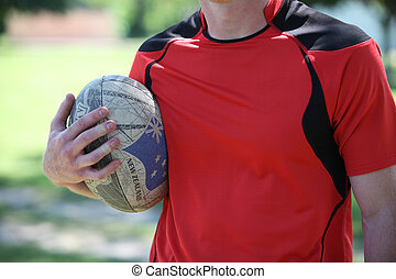 player holding rugby ball