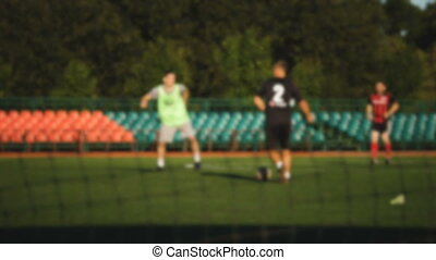 Player is attacking, amateur soccer game at the small...