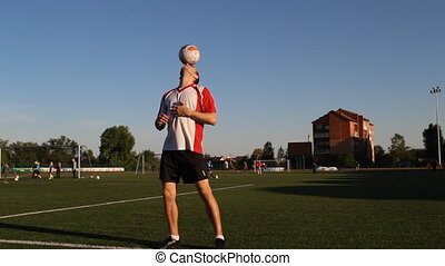 Player is balancing a ball on his nose