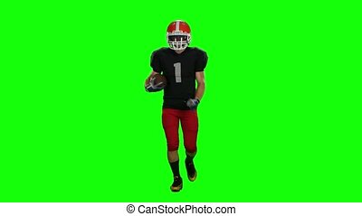 Player is running in a red helmet with the ball in his hands. Front view. Green screen