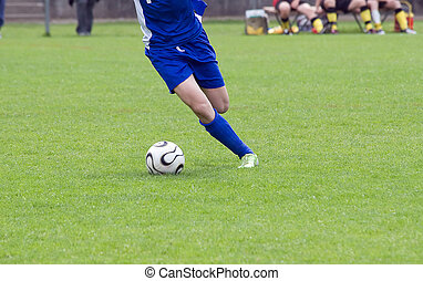 Player kicking the ball