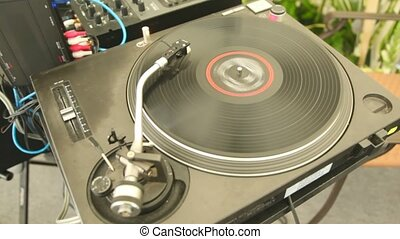 player of vinyl records twists plate and music sounds