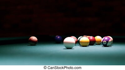 Player shooting snooker ball on snooker table 4k - Close-up...