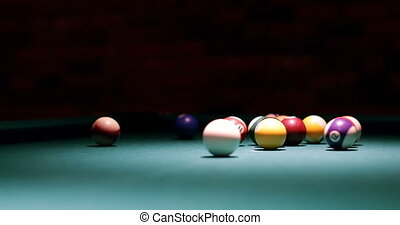 Close-up of player shooting snooker ball on snooker table 4k