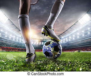 Player with a soccer ball a as world. Earth provided by NASA.