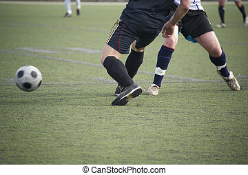 Players compete for the loose soccer ball