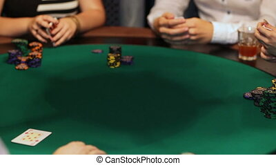 Players in the casino playing cards. poker game close-up