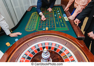 Players play roulette