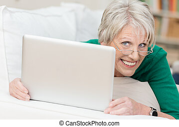Playful attractive vivacious senior woman