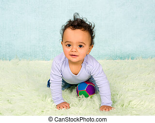Playful baby crawling