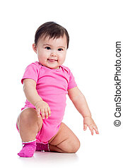 playful baby girl in studio on white background