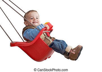 playful baby in a swing