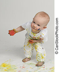 Playful baby painting