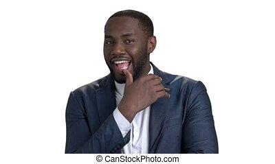 Playful black businessman. White isolated background.