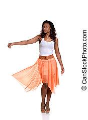 playful black woman orange skirt