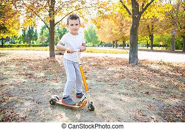 Playful boy on a scooter