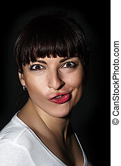 Playful caucasian woman making a funny face