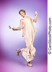 playful - Charming fashionable model in elegant light dress...