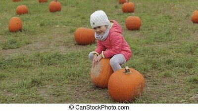 Playful child having fun in autumnal garden - Adorable...