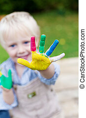Playful child showing colorful hand