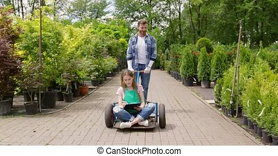 Playful colleagues of botanic garden - Man carrying charming...