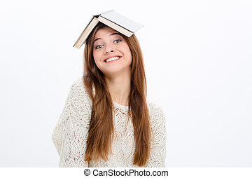 Playful comical cheerful woman with opened book on her head