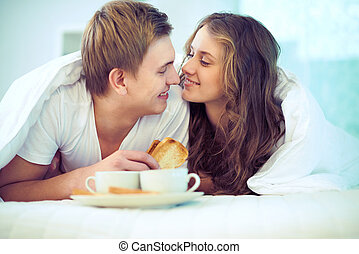 Playful couple - Couple enjoying one another while having...